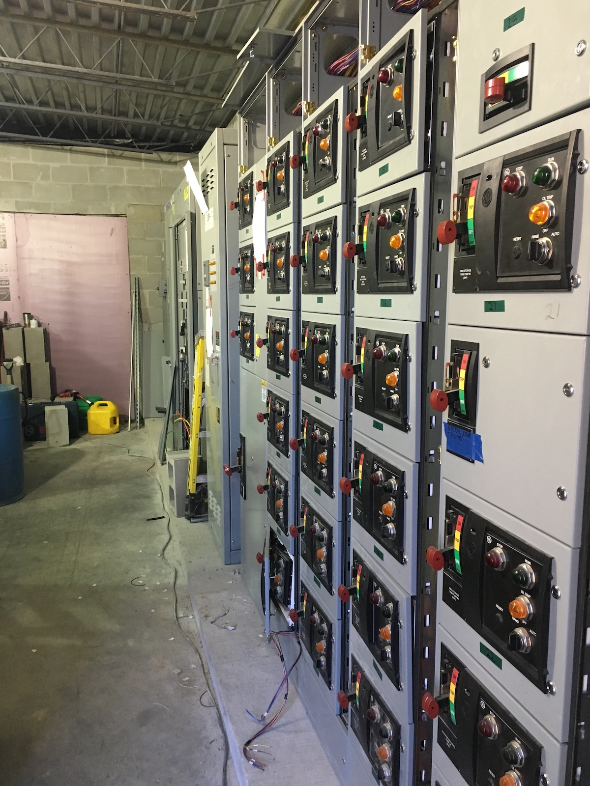 Image of industrial control panels within a facility needing round the clock service.